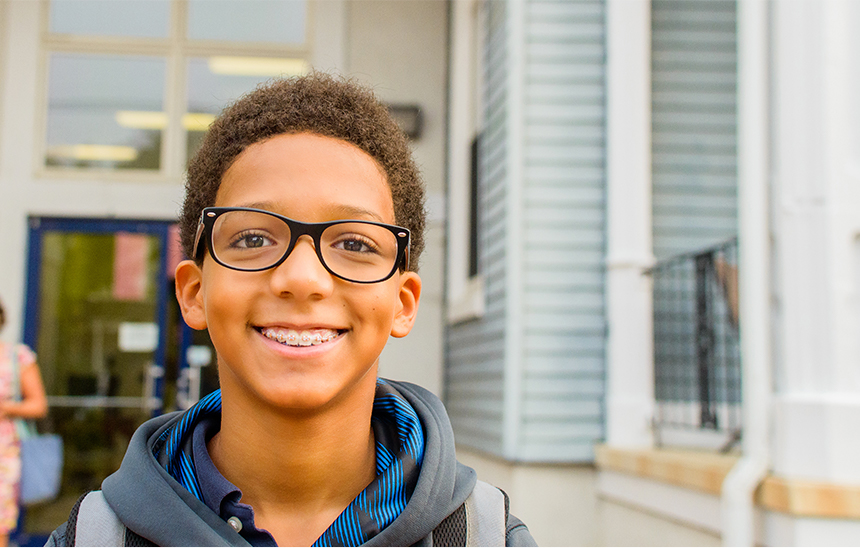 Child with glasses smiling